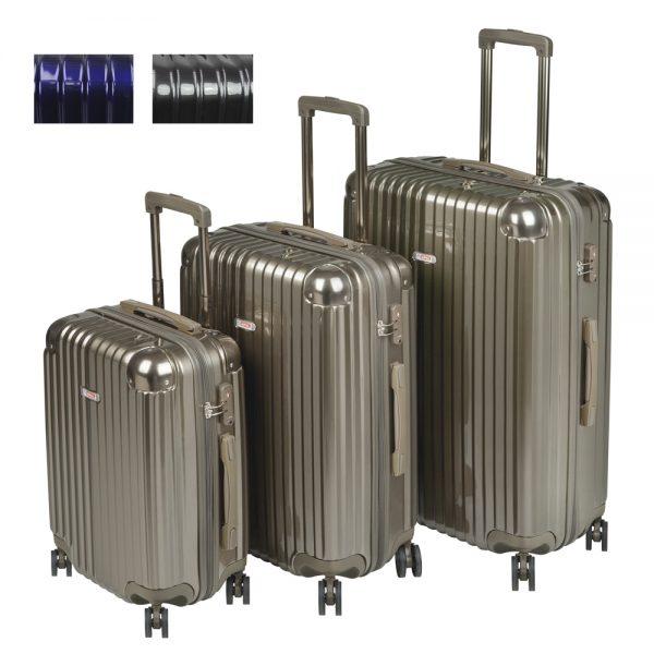 Tres maletas de viaje con ruedas.